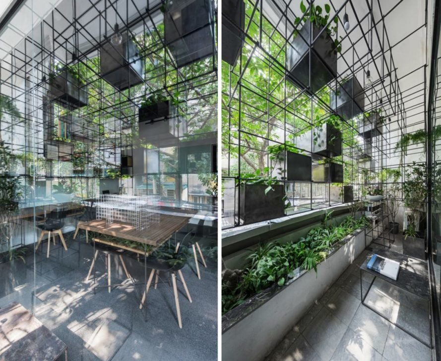 a large hanging structure made up of steel grids above an office desk