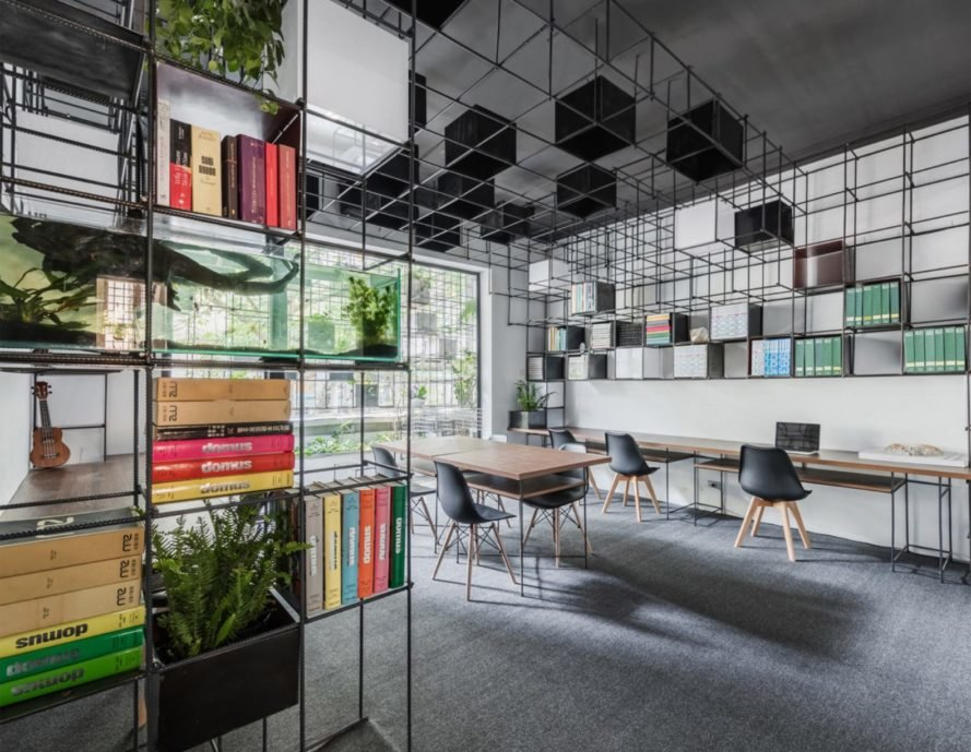 office with hanging plants and cube shelves