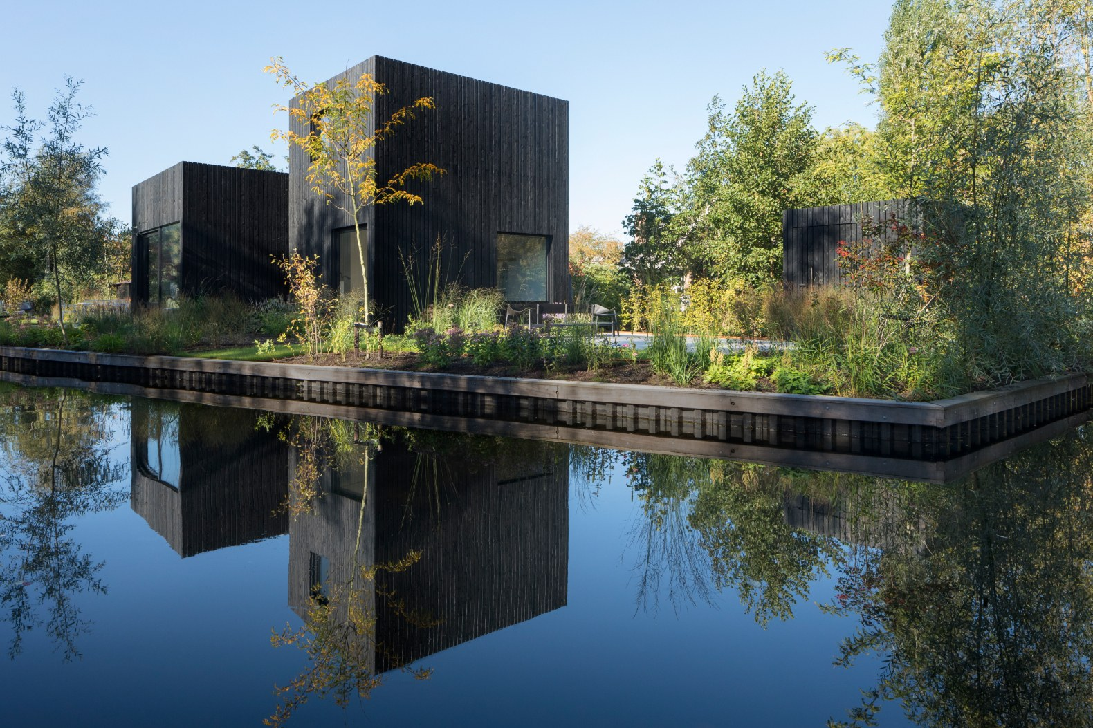 Jet black lakeside home in the Netherlands designed to embrace the surrounding nature