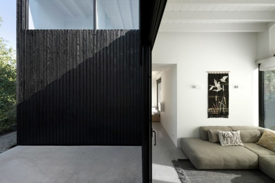 all black door opening to living space