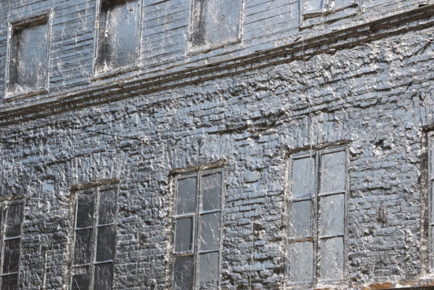 close-up of building windows wrapped in foil