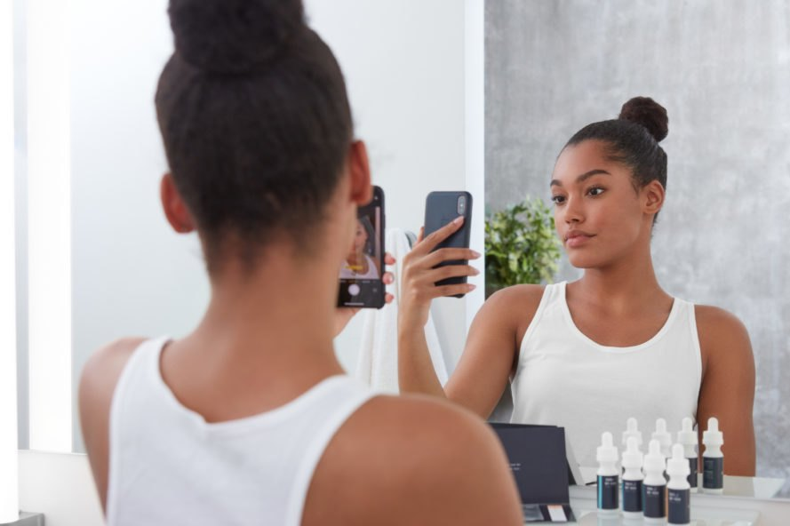 person taking skincare test on their smartphone