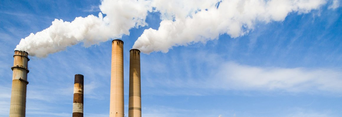 power plant with emissions pouring out