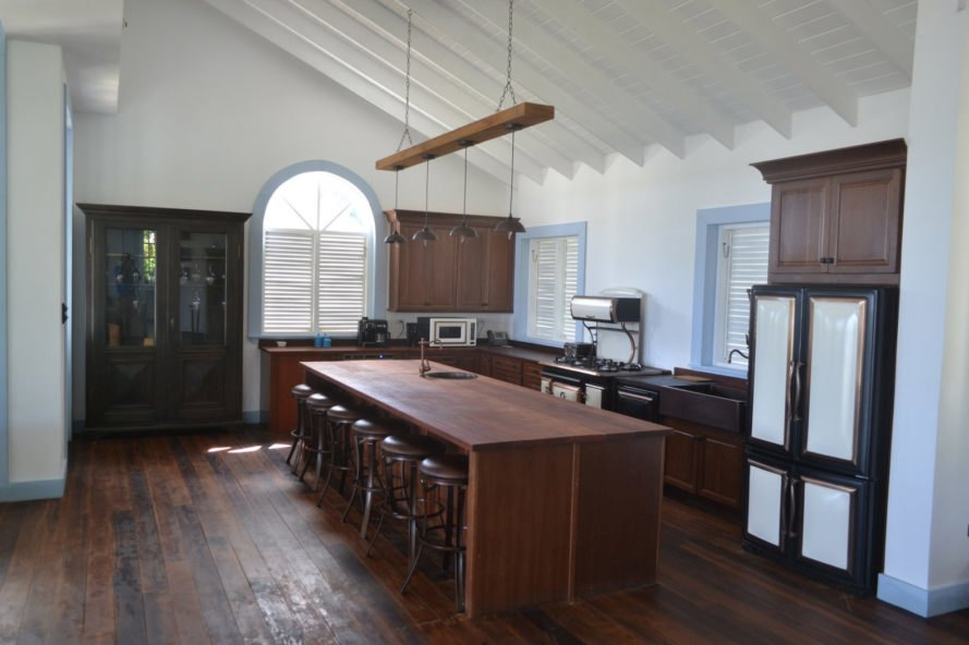 kitchen with dark wood floors and dark wood cabinets