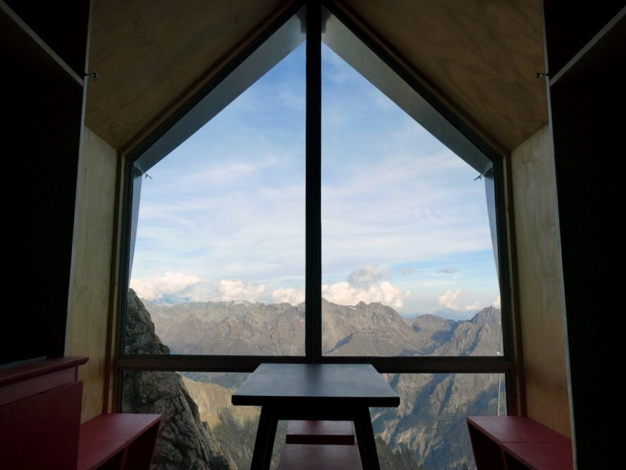 glass wall revealing mountain views