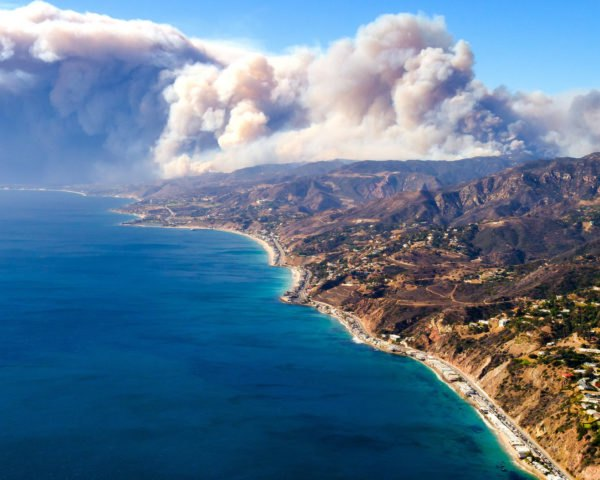 Smoke from Woolsey fire rising over California mountains and Pacific Ocean