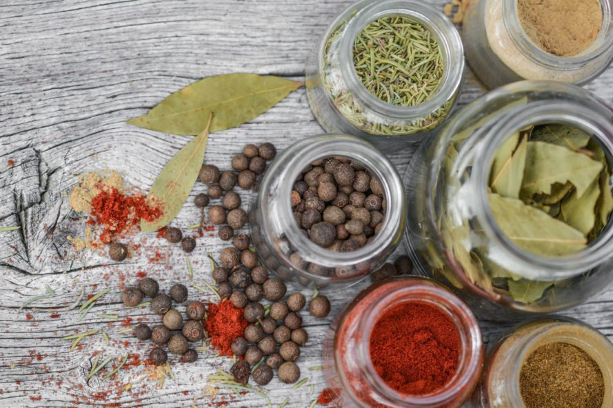 spices and seasonings in glass jars