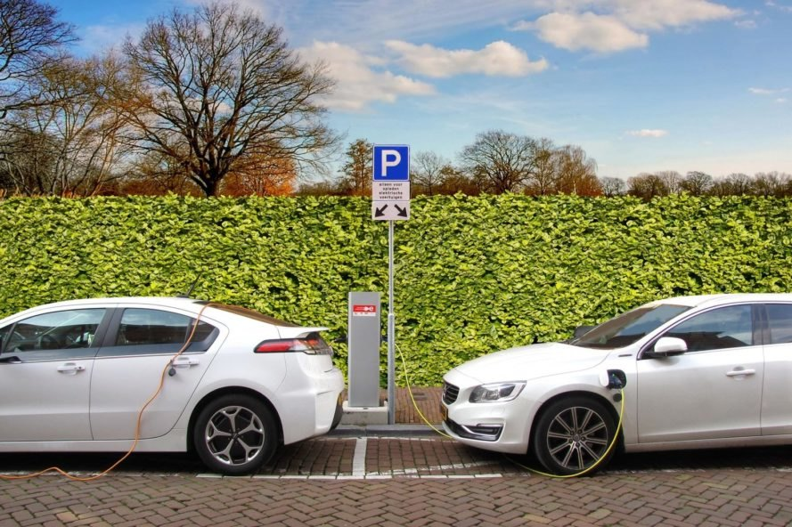 hybrid cars plugged into charging station