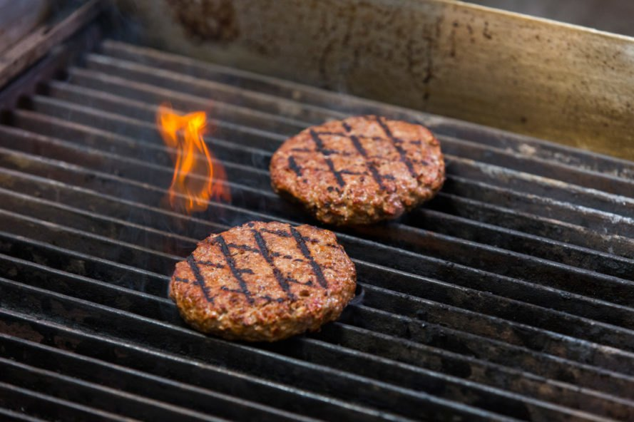 plant-based burgers on a grill