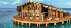 floating wood building with roof covered in solar panels
