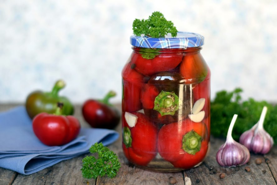 pickled peppers in a glass jar