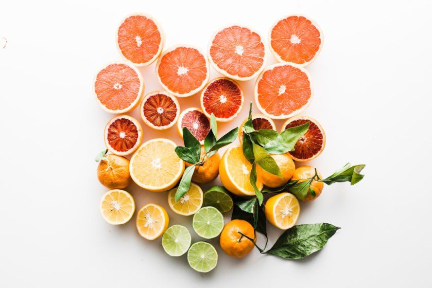 colorful citrus fruits on white background