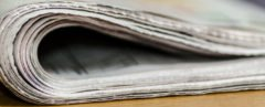 Folded newspaper on a wood table