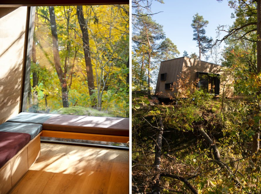 On the left, red window seat. On the right, wood cabin in a forest.