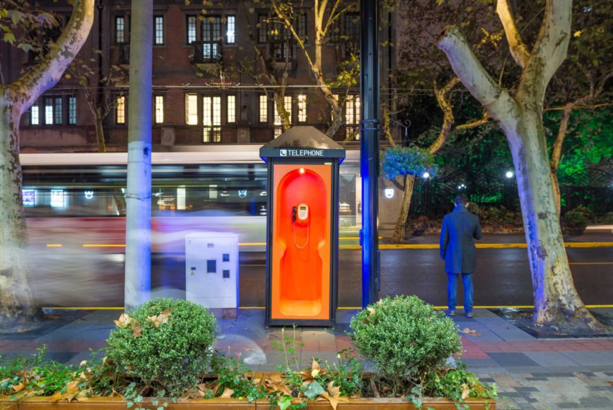 narrow phone booth with orange interior