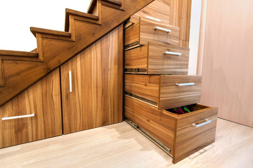 wood stairs with hidden storage compartments