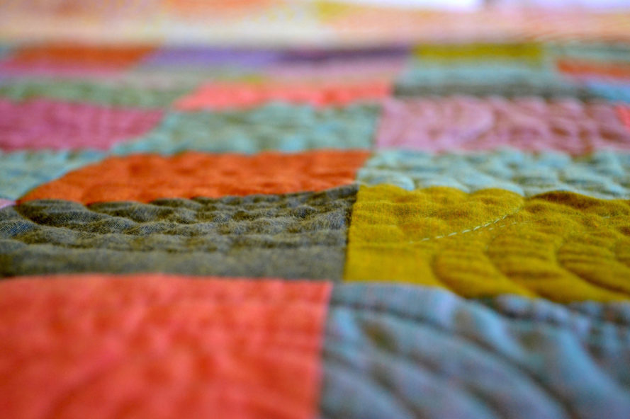 different colored patches on quilt