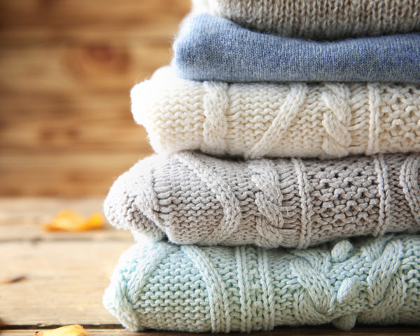 stack of folded sweaters