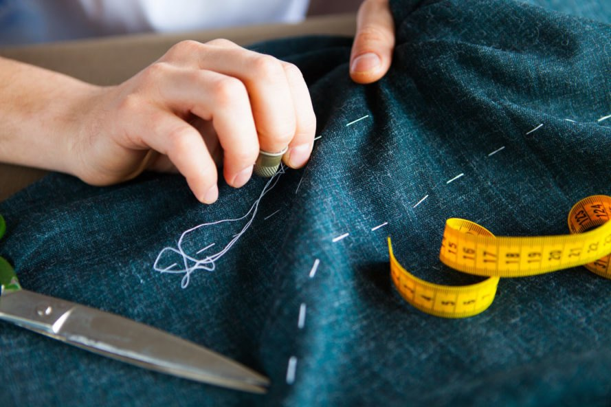 person sewing fabric