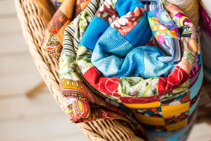 colorful quilt in a basket