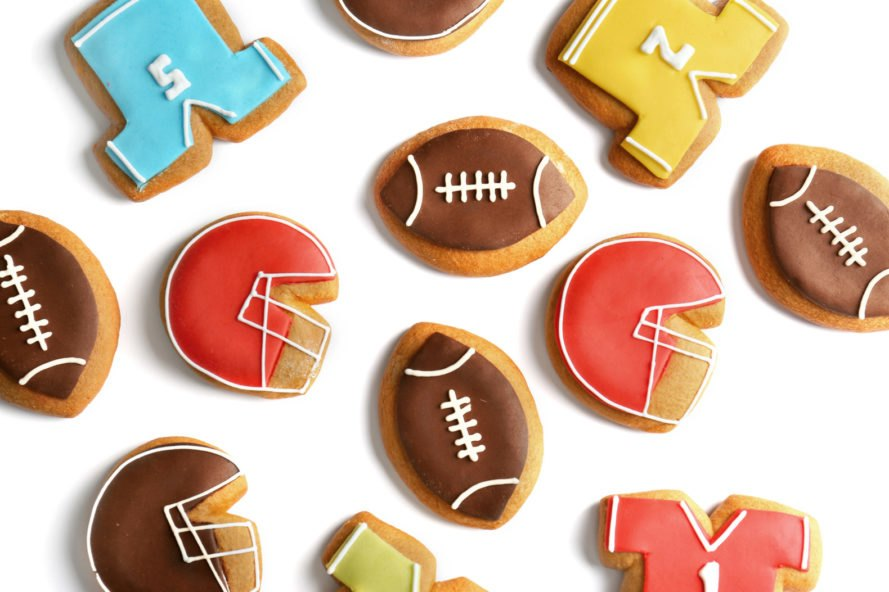 cookies in shape of jerseys and helmets