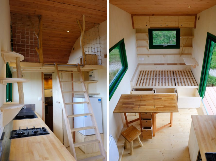 Wood-lined tiny home with small kitchen, lofted bedroom and fold-out dining table