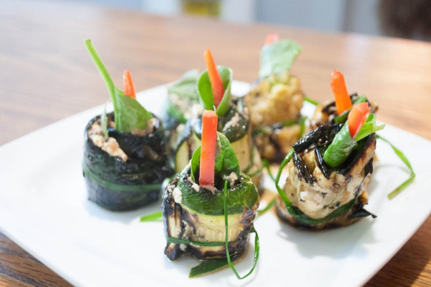grilled zucchini rolls with red peppers in the middle