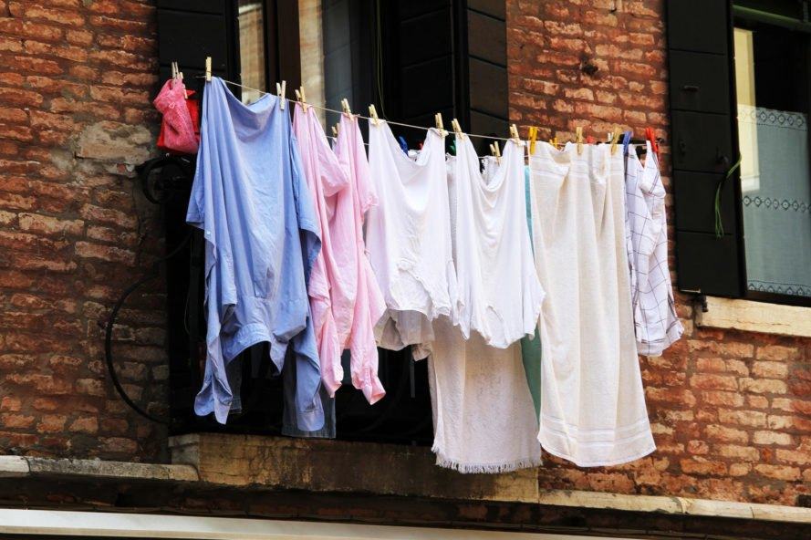 clothes drying on a line outside a brick building