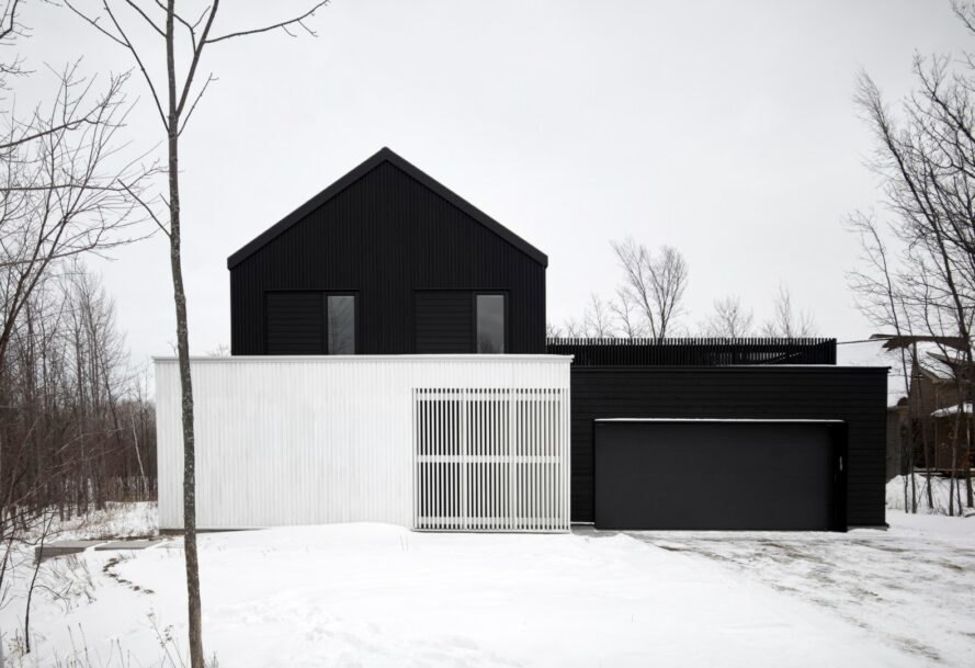 black and white home with gabled roof