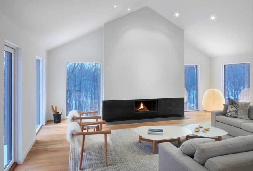 interior living space with white walls and modern fireplace