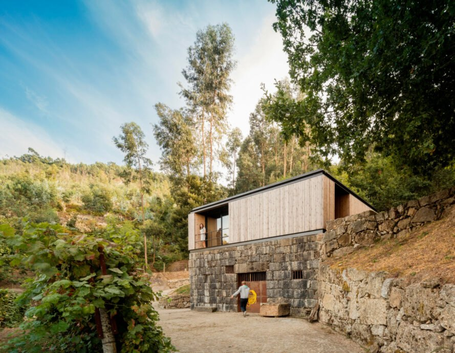 micro home clad in timber on top of granite wine cellar
