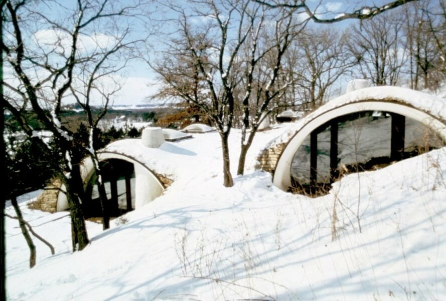 two arched structures covered in snow
