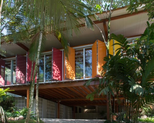 home exterior with colorful window shades