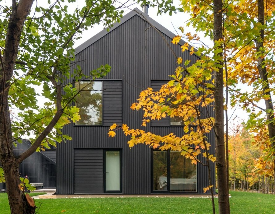 black home with pitched roof