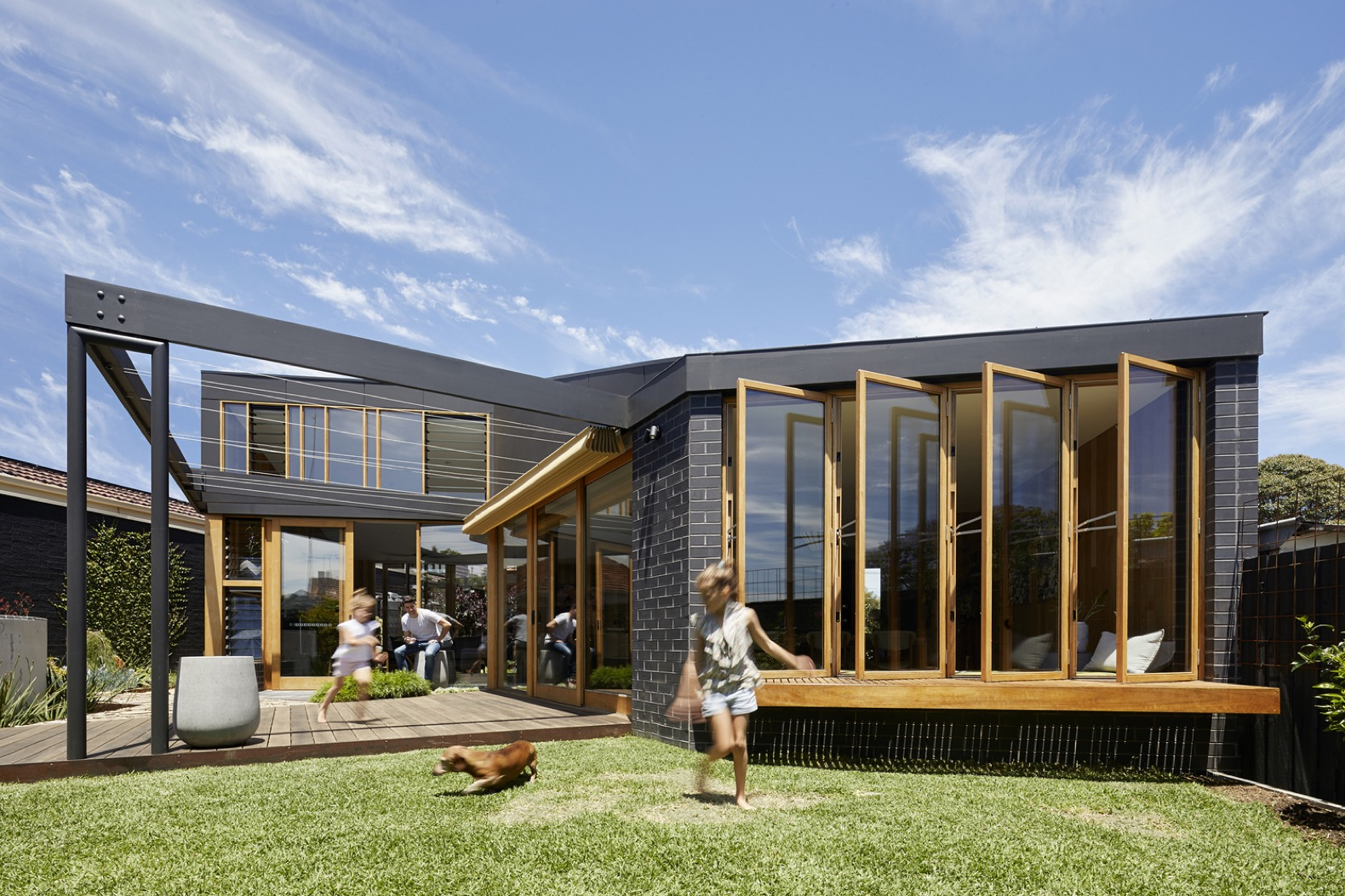 Breezy caravan-inspired annex uses passive design for thermal comfort
