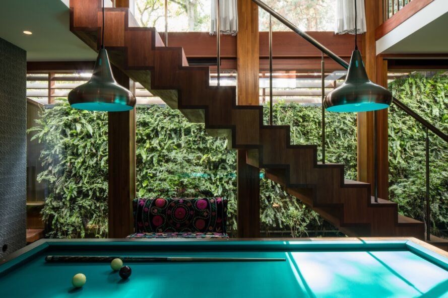 wood stairs and pool table