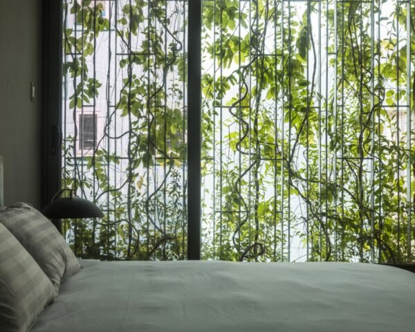 bedroom with wall covered in plants