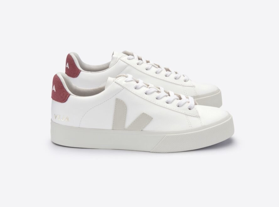 "side view white vegan sneakers with ""V"" on the side and red heel"