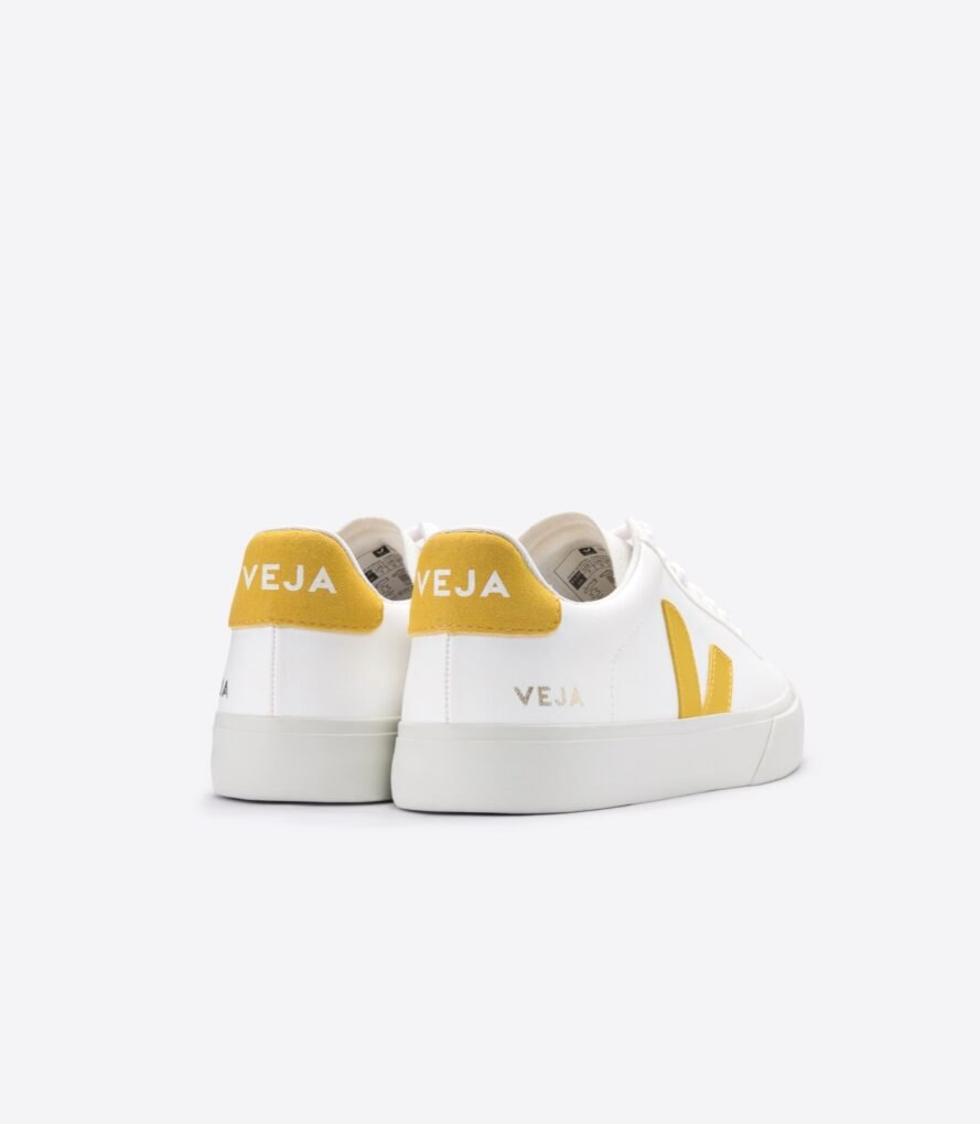 "back view white vegan sneakers with ""V"" on the side and yellow heel"