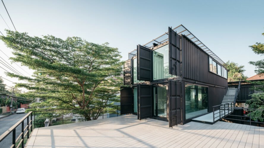 black shipping container with end walls open