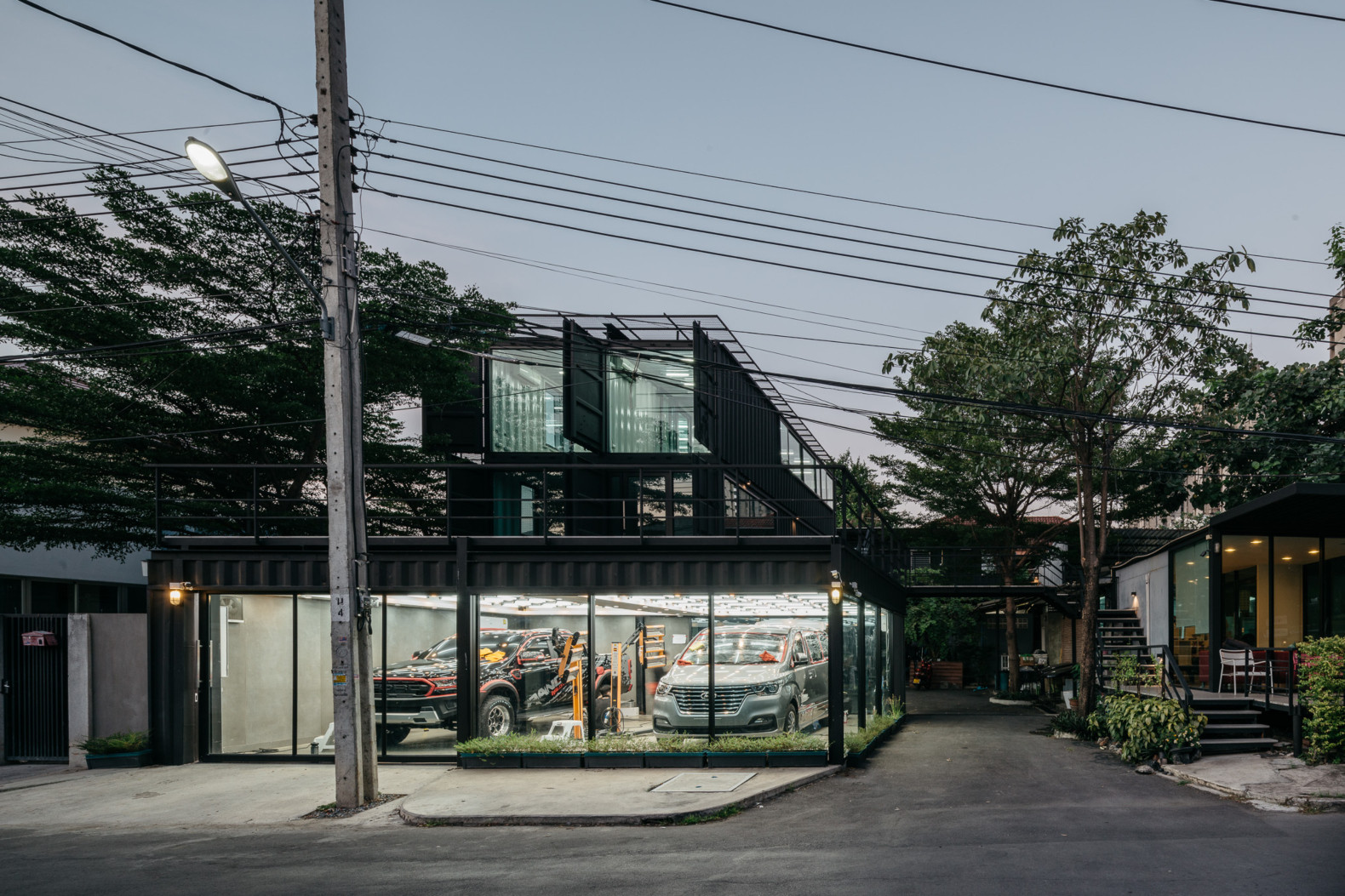 An elegant car center in Thailand is made from 8 repurposed shipping containers
