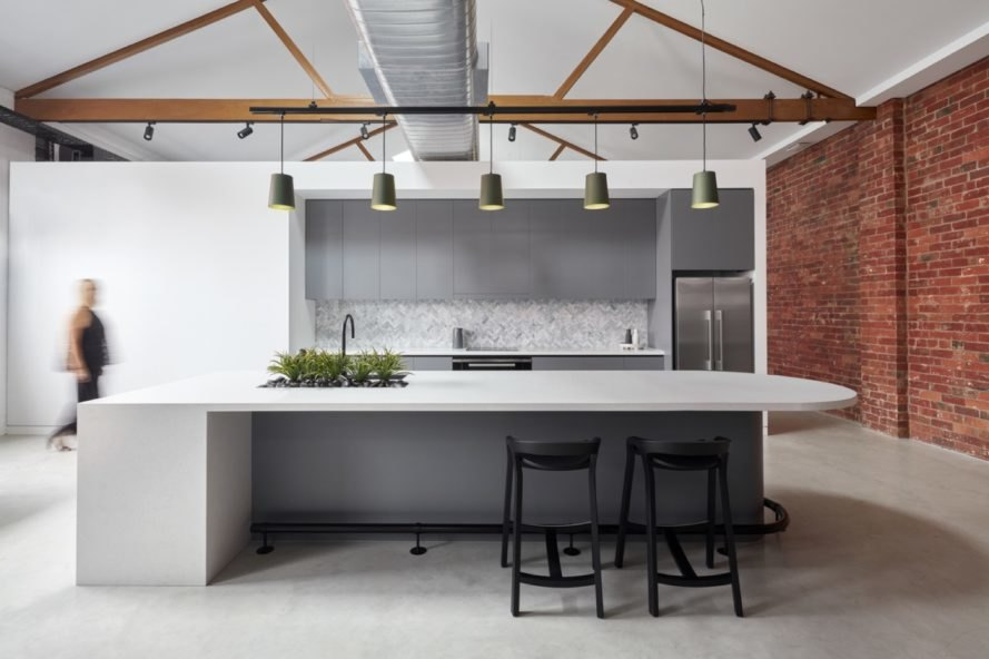 brick and white walls in the interior of the warehouse with metal furnishings