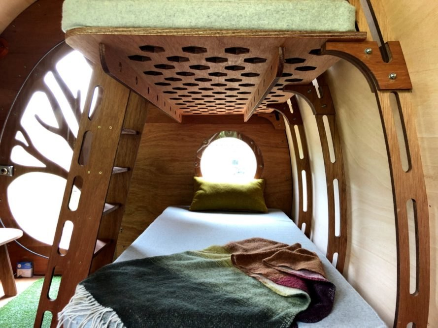 bed in timber-lined room