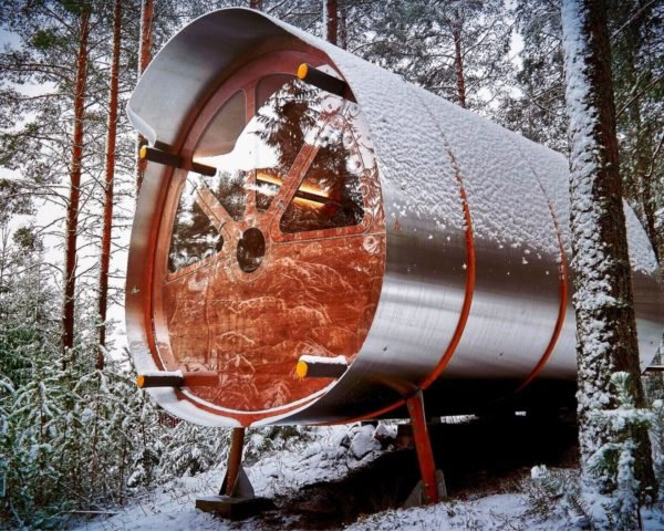 cylindrical timber and aluminum treehouse