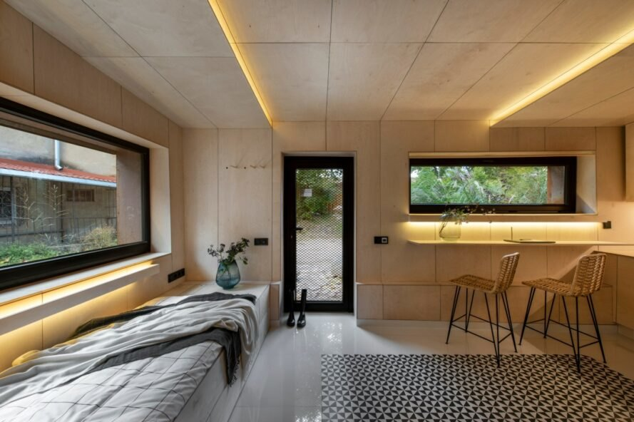 tiny interior living space with wooden walls and recessed lighting