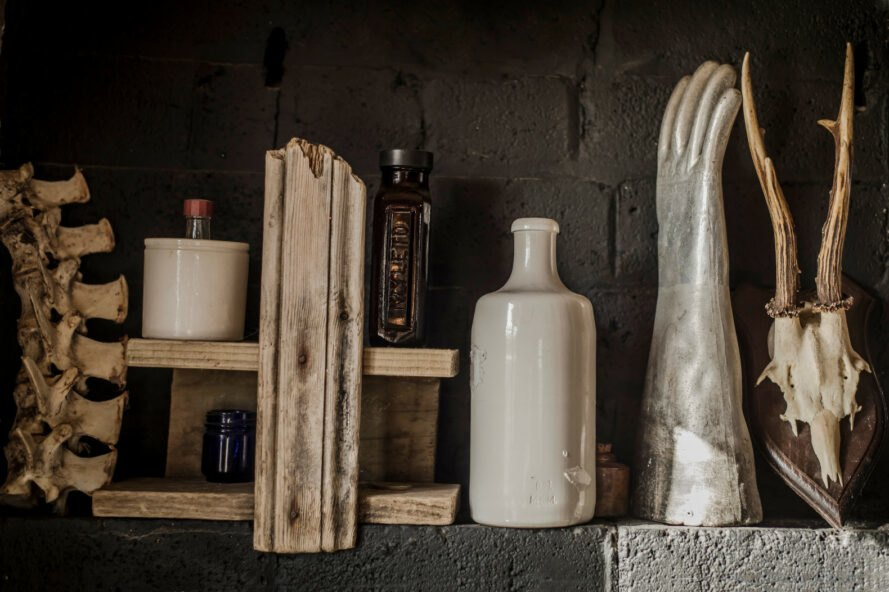 an image of bottles and a hand sculpture
