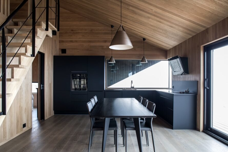 black dining set in front of a black kitchen
