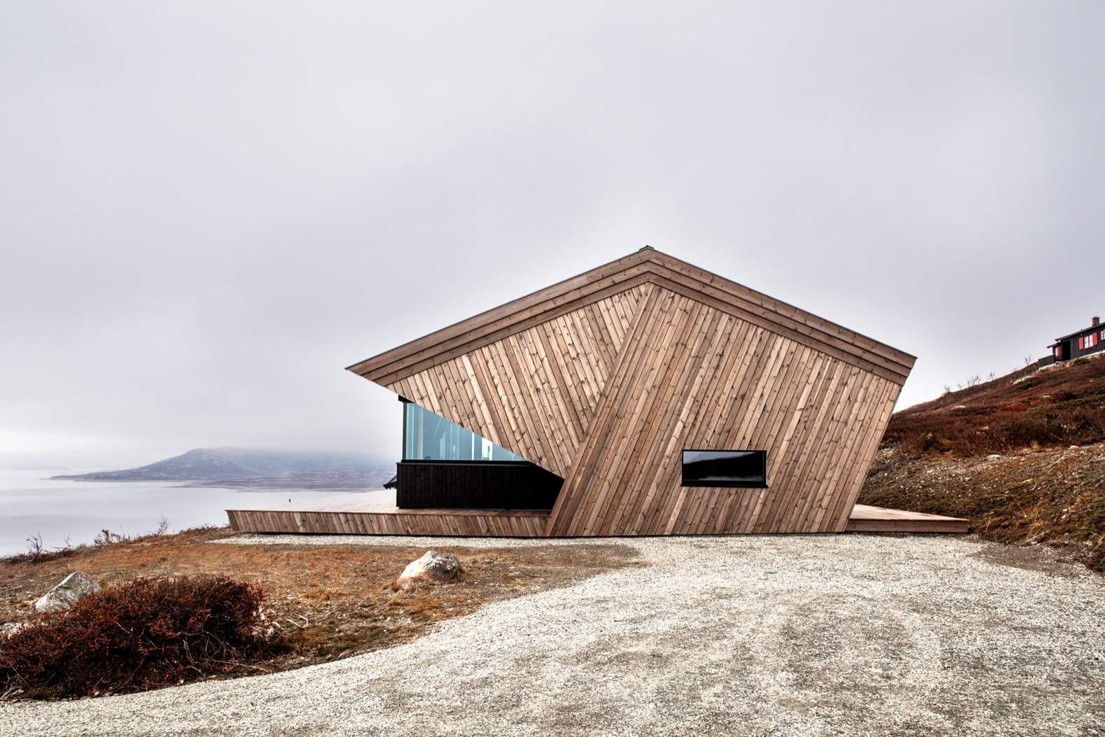 Sculptural wood cabin is an alpine retreat with magnificent views