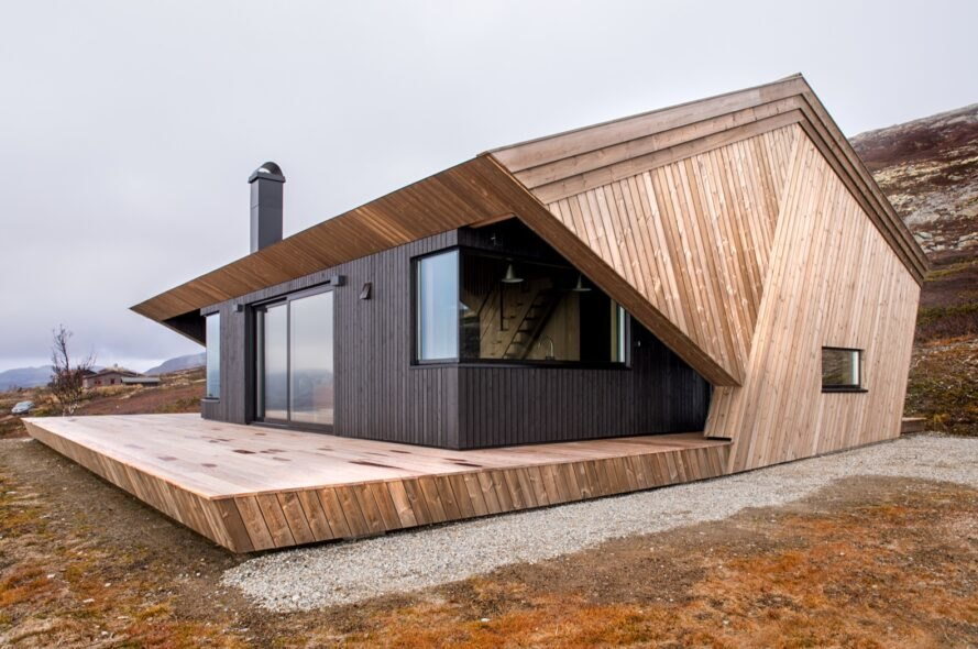 light and dark wood cabin with geometric shape