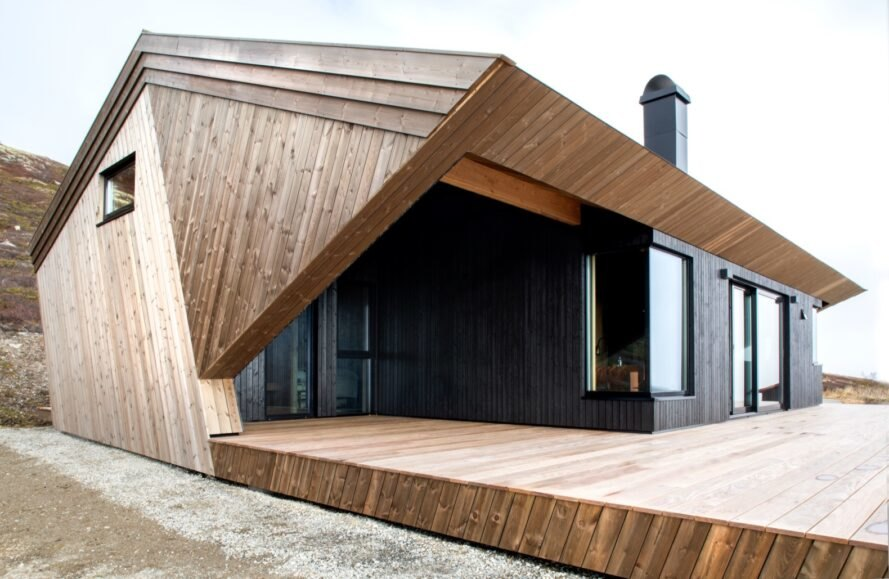 geometric wood cabin with dark front facade